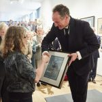 Anna Pinkster receiving the Prince of Wale's Award from Xavier Bray