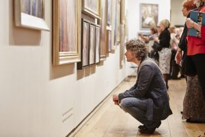 Looking at portraits, Royal Society of Portrait Painters' Annual Exhibition at Mall Galleries