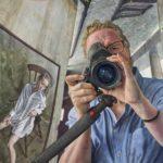 Michael Taylor 'Portrait of the photographer with seated girl' A painted portrait of a portrait photographer