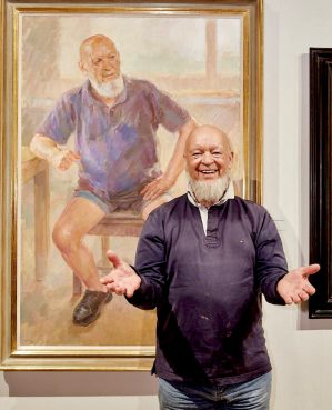 Michael Eavis with his portrait by June Mendoza